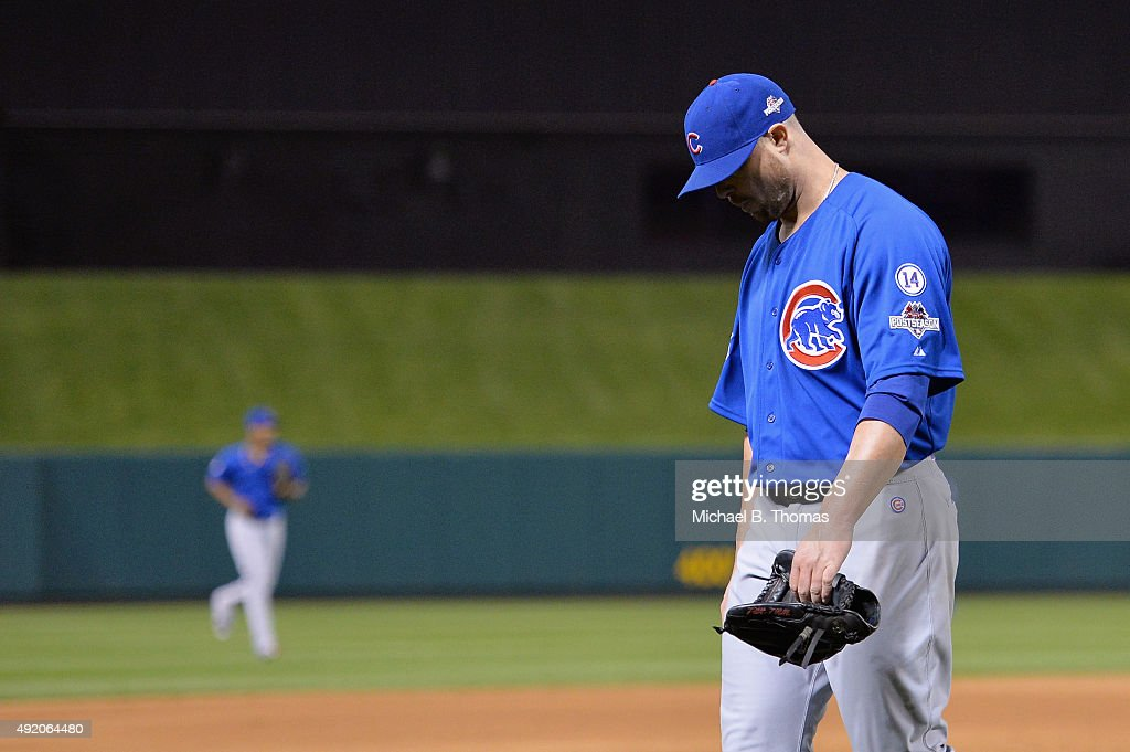 Jon Lester #34 of the Chicago Cubs walks off the field as he is relieved in the eighth inning against the St. Louis Cardinals during game one of the National League Division Series at Busch Stadium on October 9, 2015 in St Louis, Missouri. The St. Louis Cardinals defeat the Chicago Cubs with a score of 4 to 0.