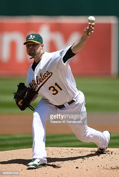 Jon Lester of the Oakland Athletics pitches against the Kansas City Royals in the top of the first inning at Oco Coliseum on August 2 2014 in Oakland...