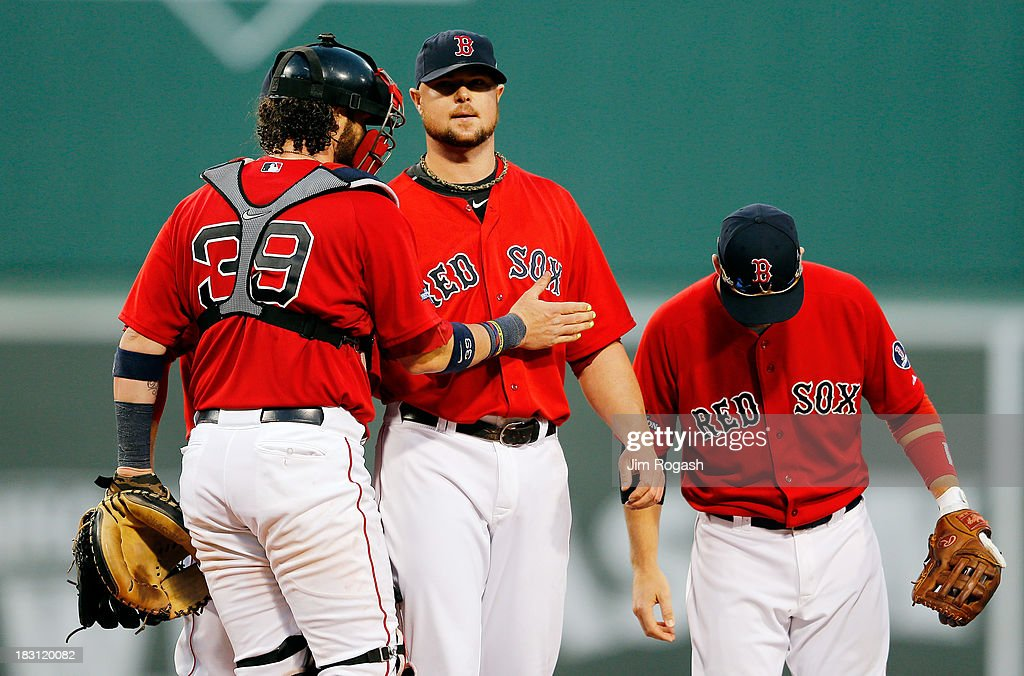 Jon Lester #31 speaks with Jarrod Saltalamacchia #39 of the Boston Red Sox during Game One of the American League Division Series against the Tampa Bay Rays at Fenway Park on October 4, 2013 in Boston, Massachusetts.