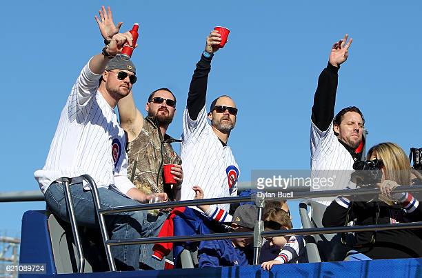 Jon Lester Travis Wood David Ross and John Lackey of the Chicago Cubs celebrate during the 2016 World Series victory parade on November 4 2016 in...