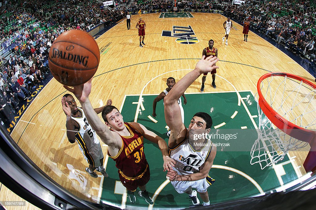 Jon Leuer #30 of the Cleveland Cavaliers puts the shot up over Enes Kanter #0 of the Utah Jazz at Energy Solutions Arena on January 19, 2013 in Salt Lake City, Utah.