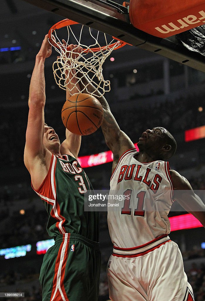 Jon Leuer #30 of the Milwaukee Bucks dunks the ball over Ronnie Brewer #11 of the Chicago Bulls at the United Center on February 22, 2012 in Chicago, Illinois.