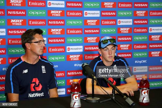 Jon Lewis coach of England and captain Harry Brook speak to mead at the press conference after the ICC U19 Cricket World Cup Quarter Final match...