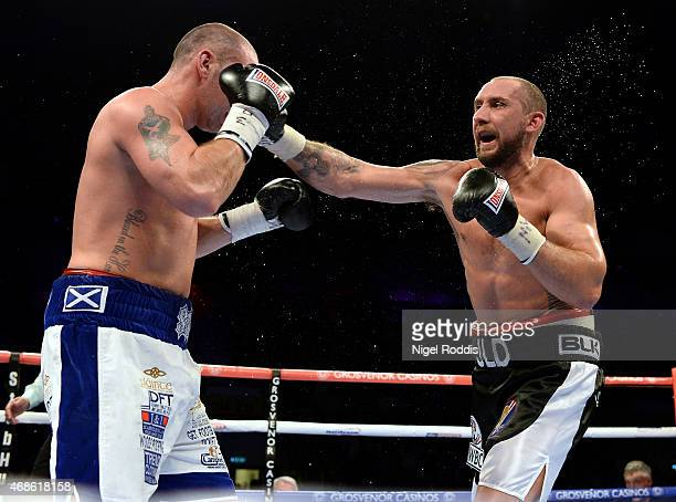 Jon Lewis Dickinson in action with Stephen Simmons during their WBC International Silver Cruiserweight Championship boxing contest at the Metro Arena...
