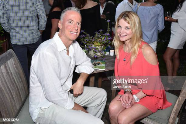 Jon LoPresti and Gwendolyn Beck attend AVENUE on the Beach's Summer Soiree at The Baker House on August 12 2017 in East Hampton New York