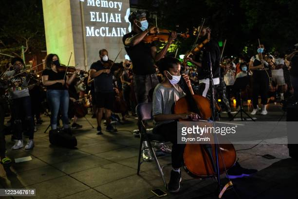 Jon Luc Jobson of Queens joins fellow string players as they perform during a violin vigil for Elijah McClain in Washington Square Park on June 29...