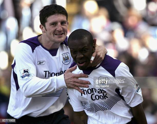Jon Macken and Shaun WrightPhillips celebrate after City go one up during the Barclays Premiership match between Aston Villa and Manchester City at...