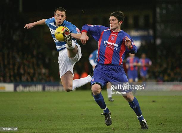 Jon Macken of Crystal Palace tries to tackle Nicky Shorey of Reading during the CocaCola Championship match between Crystal Palace and Reading at...