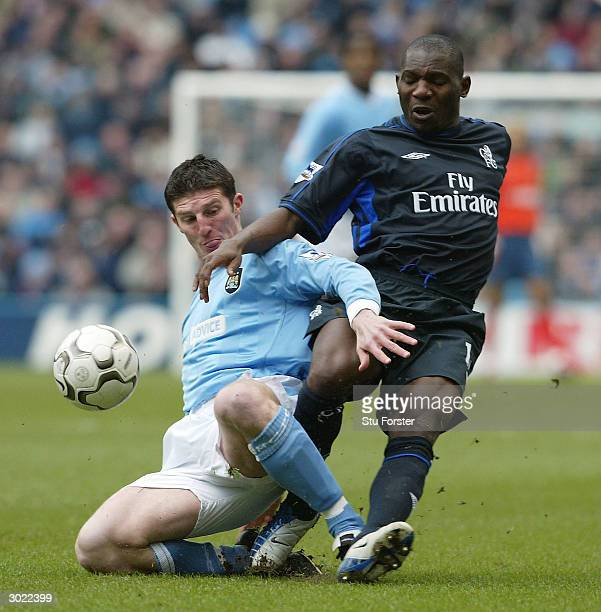 Jon Macken of Man City clashes with Geremi of Chelsea during the FA Barclaycard Premiership match between Manchester City and Chelsea at The City of...
