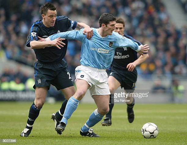 Jon Macken of Man City clashes with John Terry of Chelsea during the FA Barclaycard Premiership match between Manchester City and Chelsea at The City...