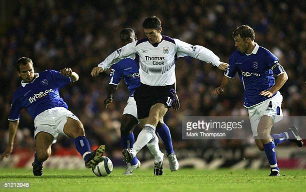 Jon Macken of Man City goes past Stephen Clemence and Kenny Cunningham of Birmingham during the FA Barclaycard Premiership match between Birmingham...