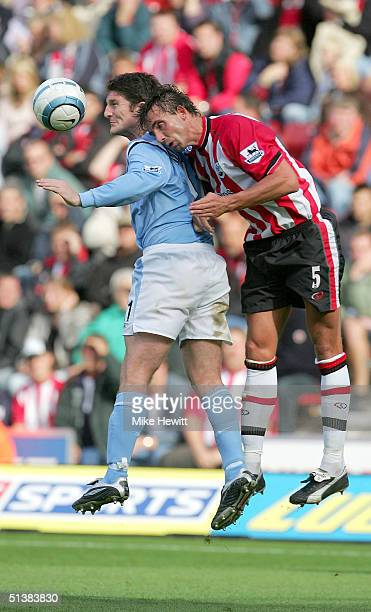 Jon Macken of Manchester City challenges Claus Lundekvam of Southampton during the Barclays Premiership match between Southampton and Manchester City...