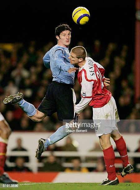 Jon Macken of Manchester City challenges in the air with Philippe Senderos of Arsenal during the Barclays Premiership match between Arsenal and...
