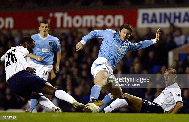 Jon Macken of Manchester City tries to takes the ball past Tottenham Hotspurs' Dean Richards and Ledley King during the FA Cup 4th Round Replay match...