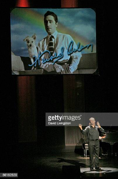 Jon Maher performs using sign language beneath a photograh of Harold Arlen at the Actor's Fund STAGE Too Tribute Hooray For Love celebrating the...