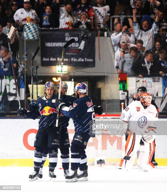 Jon Matsumoto of Muenchen is congratulated after scoring the first goal during the DEL PlayOffs Final Match 5 between EHC Muenchen and the Grizzlys...