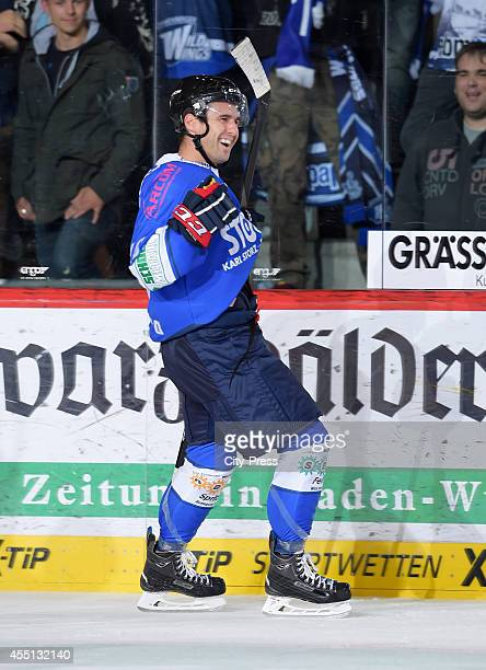 Jon Matsumoto of Schwenninger Wild Wings celebrates during the action shot on august 17, 2014 in Schwenningen, Germany.