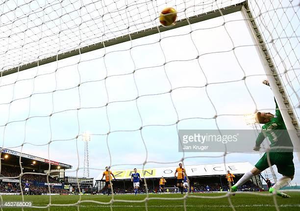Jon McLaughlin Goalkeeper of Bradford City sees a shot at goal from Jonson ClarkeHarris of Oldham Athletic hit the back of the net during the Sky Bet...