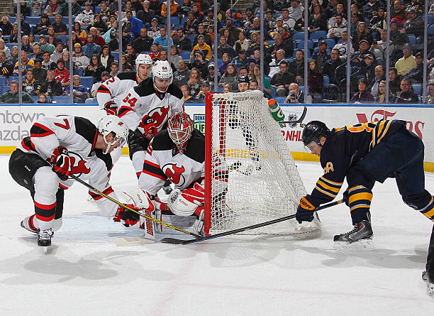 f5fed257557 ... best price jon merrill 7 and cory schneider 35 of the new jersey devils  stop a