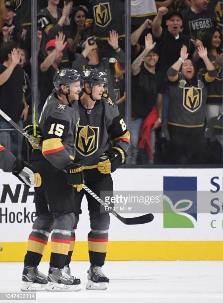 Jon Merrill and Nick Holden of the Vegas Golden Knights celebrate after Holden scored a firstperiod goal against the San Jose Sharks during their...