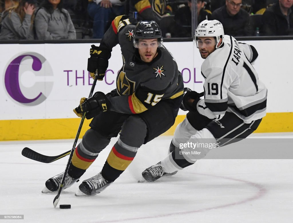 Jon Merrill #15 of the Vegas Golden Knights skates with the puck against Alex Iafallo #19 of the Los Angeles Kings in the first period of their game at T-Mobile Arena on February 27, 2018 in Las Vegas, Nevada. The Kings won 4-1.