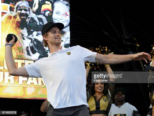 Jon Merrill of the Vegas Golden Knights throws Tshirts to the crowd as he is introduced at the team's 'Stick Salute to Vegas and Our Fans' event at...