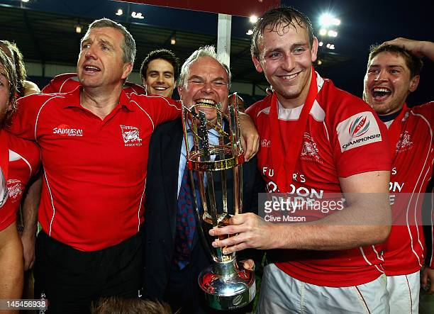 Jon Mills of London Welsh celebrates with the trophy and Bleddyn Phillips, Chairman of London Welsh after victory during the RFU Championship Playoff...