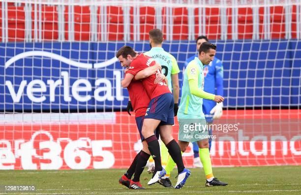 Jon Moncayola of Osasuna celebrates with team mate Roberto Torres after scoring their side's third goal during the La Liga Santander match between...