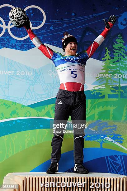 Jon Montgomery of Canada celebrates the gold medal during the flower ceremony for the men's skeleton on day 8 of the 2010 Vancouver Winter Olympics...