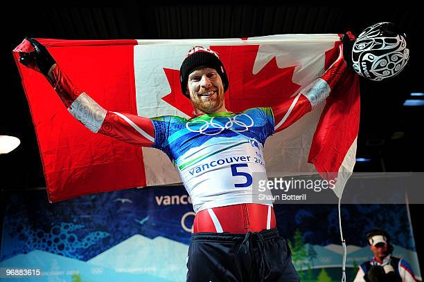 Jon Montgomery of Canada celebrates winning the gold medal during the flower ceremony for the men's skeleton on day 8 of the 2010 Vancouver Winter...