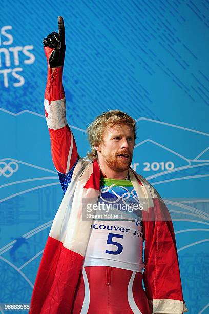 Jon Montgomery of Canada reacts after he won the gold medal in the men's skeleton on day 8 of the 2010 Vancouver Winter Olympics at the Whistler...