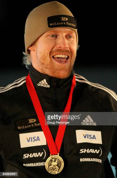 Jon Montgomery of Canada takes the podium after winning the gold medal in the men's skeleton competition at the Bobsleigh and Skeleton World Cup at...