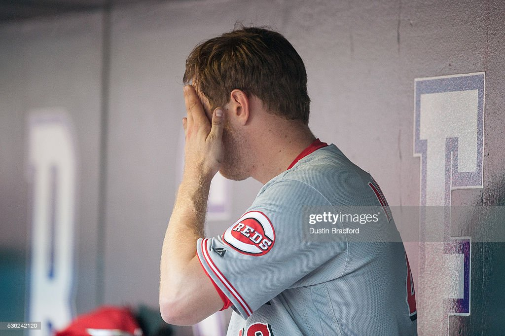 Jon Moscot #46 of the Cincinnati Reds reacts in the dugout after allowing 8 runs, including four home runs, in 2-plus innings of work against the Colorado Rockies at Coors Field on May 31, 2016 in Denver, Colorado.