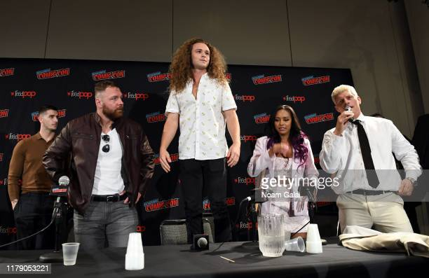 Jon Moxley Jack Perry aka Jungle Boy Brandi Rhodes and Cody Rhodes attends the All Elite Wrestling panel during 2019 New York Comic Con at Jacob...