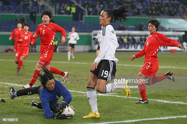 Jon Myong Hui of North Korea saves the ball against Fatmire Bajramaj of Germany during the Women's international friendly match between Germany and...