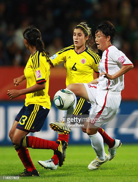 Jon Myong Hwa of Korea DPR and Daniela Montoya of Colombia battle for the ball during the FIFA Women's World Cup 2011 Group C match between Korea DPR...