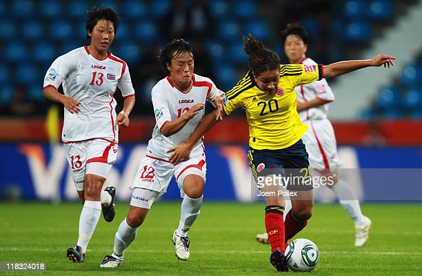 Jon Myong Hwa of Korea DPR and Orianica Velasquez of Colombia battle for the ball during the FIFA Women's World Cup 2011 Group C match between Korea...