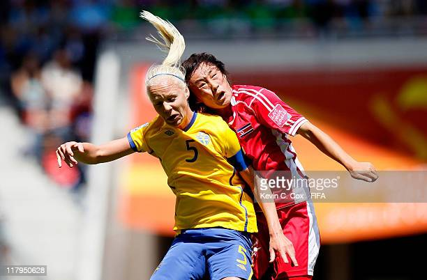 Jon Myong Hwa of Korea DPR collides with Caroline Seger of Sweden while battling for a header during the FIFA Women's World Cup 2011 Group C match...
