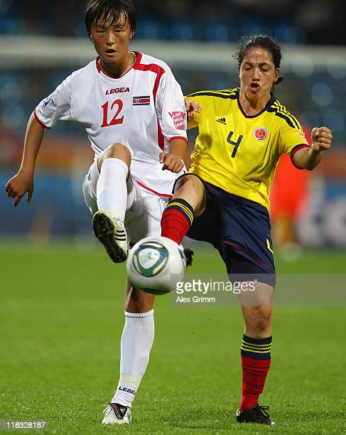 Jon Myong Hwa of Korea DPR is challenged by Diana Ospina of Colombia during the FIFA Women's World Cup 2011 Group C match between Korea DPR and...