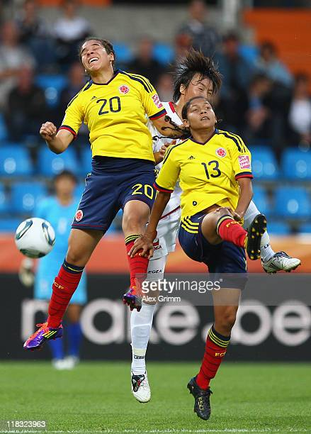 Jon Myong Hwa of Korea DPR jumps for a header with Orianica Velasquez and Yulieth Dominguez of Colombia during the FIFA Women's World Cup 2011 Group...