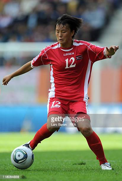 Jon Myong Hwa of Korea DPR runs with the ball during the FIFA Women's World Cup Group C match between Korea DPR and Sweden at FIFA World Cup Stadium...