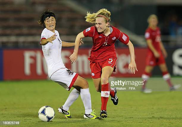 Jon Myong Hwa of Korea DPR tries to tackle Sarah Robbins of Canada during the FIFA U20 Women's World Cup Japan 2012 Group C match between Canada and...