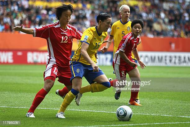 Jon Myong Hwa of North Korea challenges Therese Sjogran of Sweden during the FIFA Women's World Cup 2011 Group C match between North Korea and Sweden...