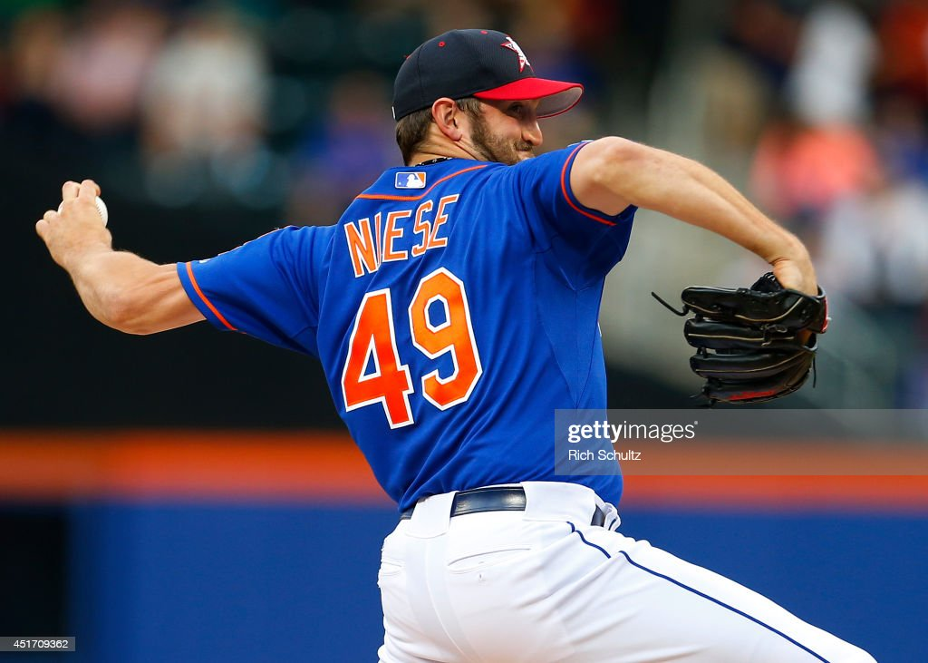 Jon Niese #49 of the New York Mets delivers a pitch against the Texas Rangers during the first inning on July 4, 2014 at Citi Field in the Flushing neighborhood of the Queens borough of New York City.