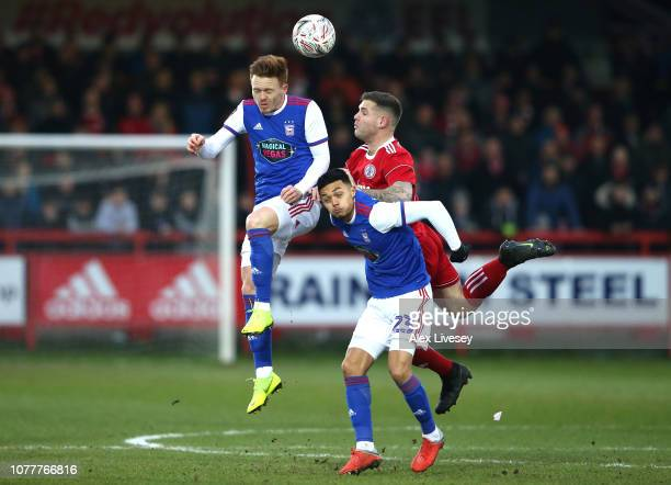 Jon Nolan of Ipswich Town wins a header over Billy Kee of Accrington Stanley as he challeges Andre Dozzell of Ipswich Town during the FA Cup Third...