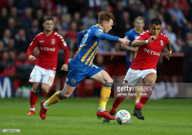 Jon Nolan of Shrewsbury Town and Ahmed Kashi of Charlton Athletic during the Sky Bet League One Play Off Semi FinalFirst Leg between Charlton...