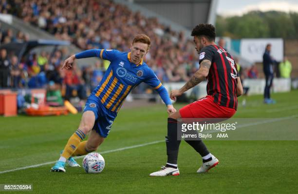 Jon Nolan of Shrewsbury Town and Derrick Williams of Blackburn Rovers during the Sky Bet League One match between Shrewsbury Town and Blackburn...