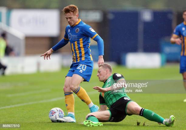 Jon Nolan of Shrewsbury Town and Sam Mantom of Scunthorpe United during the Sky Bet League One match between Shrewsbury Town and Scunthorpe United at...