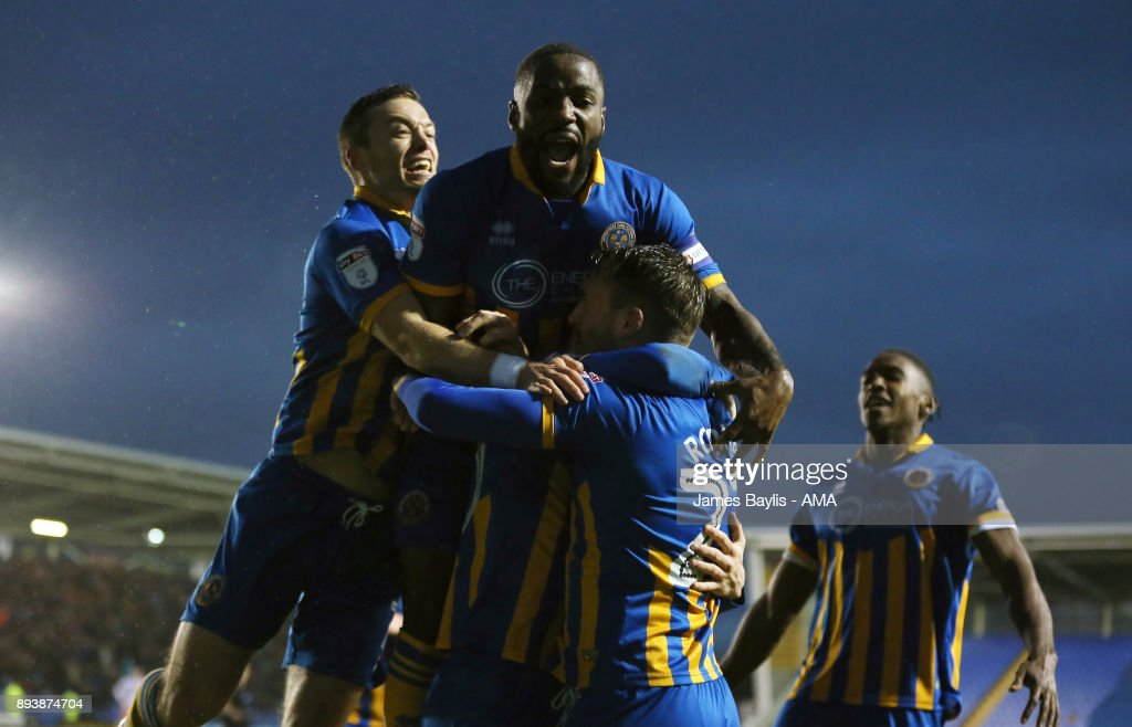 Jon Nolan of Shrewsbury Town celebrates with his team mates after scoring a goal to make it 1-0 during the Sky Bet League One match between Shrewsbury Town and Blackpool at New Meadow on December 16, 2017 in Shrewsbury, England.