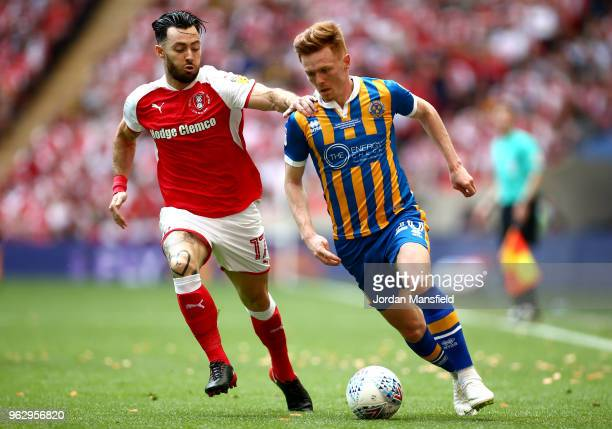 Jon Nolan of Shrewsbury Town takes on Richie Towell of Rotherham United during the Sky Bet League One Play Off Final between Rotherham United and...